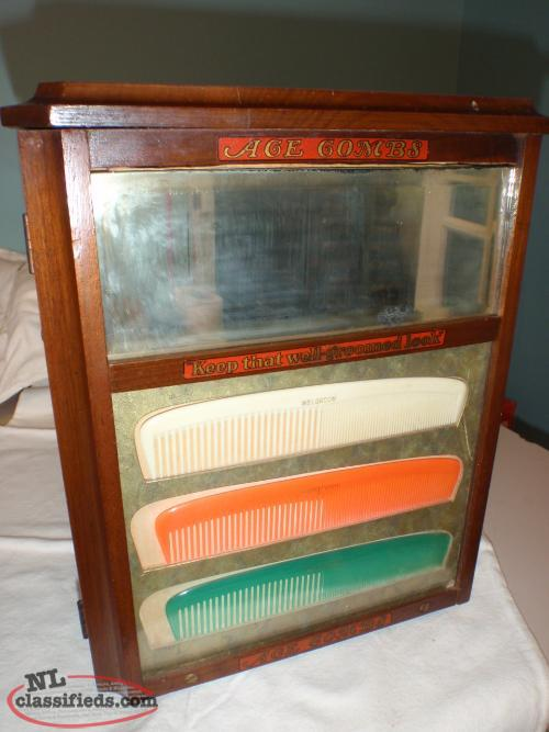 antique ace comb display cabinet with combs