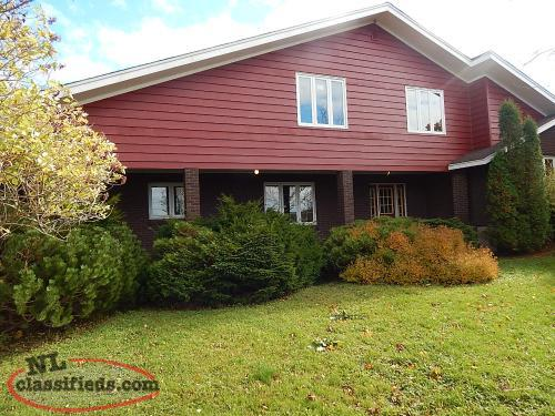 Spacious multi level home on a beautiful large lot with paved parking