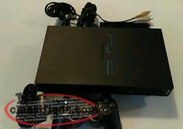 Black PS2 console with Black 1st party controller and hookups