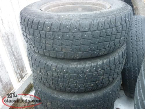 4 15IN. AVALANCHE X-TREME STUDDED TIRES P215/70R15 ON 5 HOLE RIMS OFF 2004 FORD
