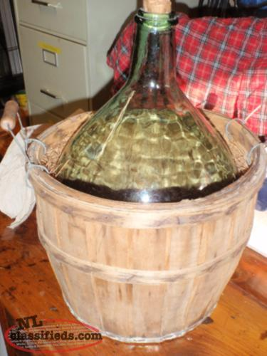 old st. pierre et miquelon wine bottle in basket