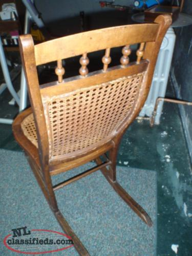 antique wicker nursing rocking chair .