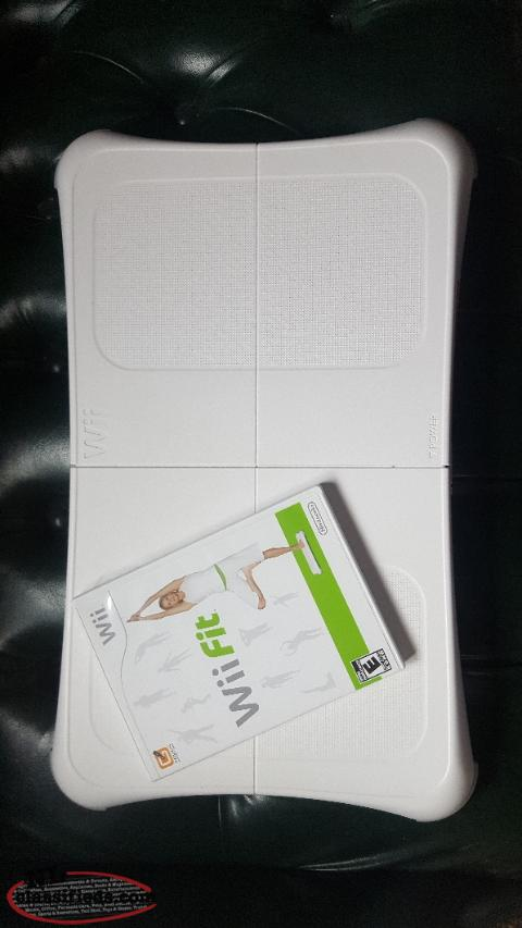Wii fit balance board and wii fit game disk.