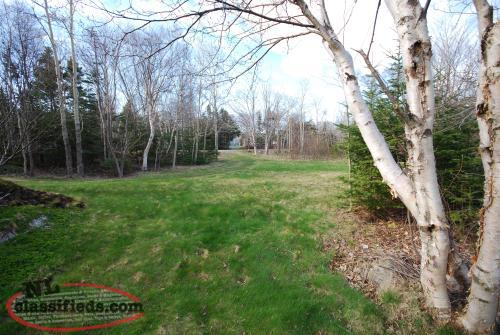 TREED WITH PRIVACY SERIVED 1/2 LOT
