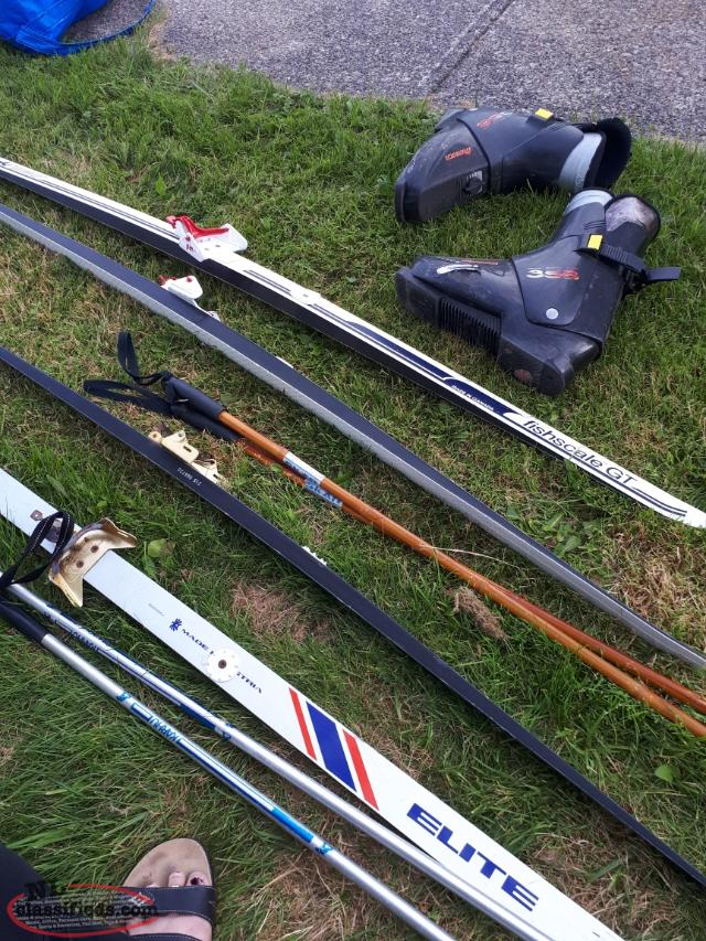 2 sets of skis n poles