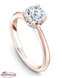 1 carat diamond engagement ring with gold setting encrusted in diamonds
