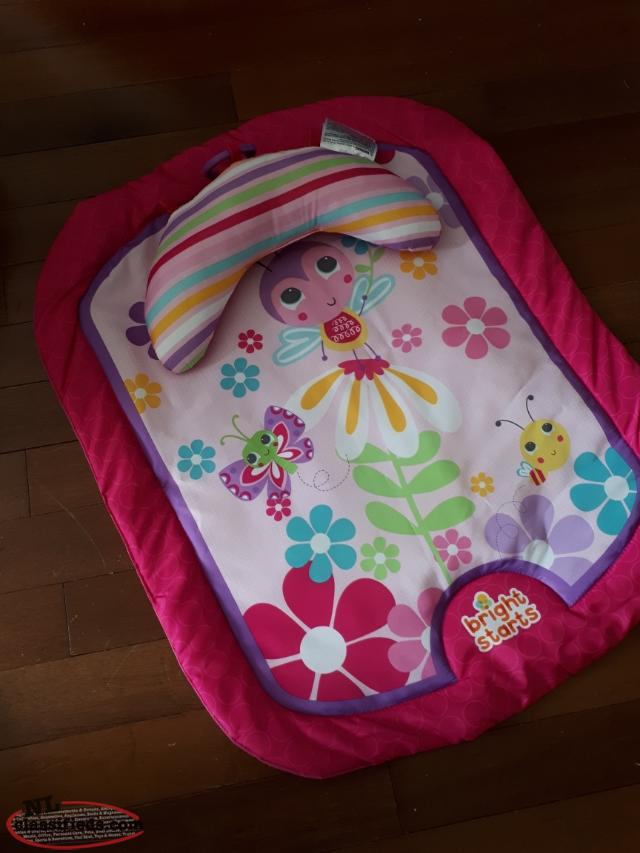 pink tummy time mat