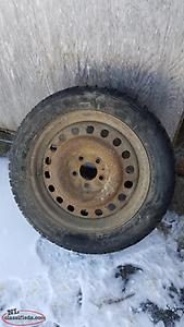 4--215/55/17 studded winter tires and rims