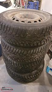 4 studded 215/65 R16 tires and rims
