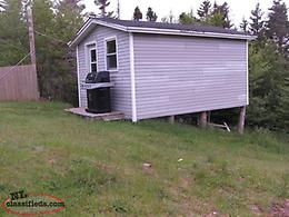 Bungalow with basement and storage shed