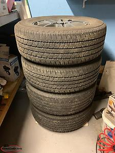 4 225/65/16 Tires on rims