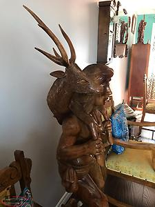 Hand carved Native Man With Deer On Back
