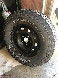 4-265/70/17s On Dodge Ram Wheels Like New