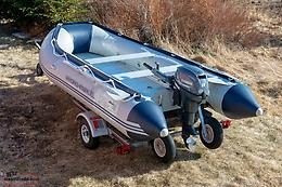 Inflatable boat , motor and trailer