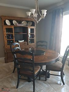 Table and chairs with matching hutch