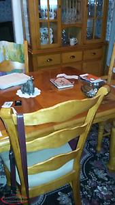 Wooden table with six padded chairs