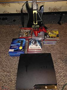 PlayStation 3 two controllers and 24 games