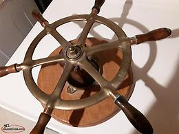 Antique ship's wheel and compass