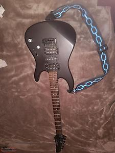 trade for a piano! matte black guitar with pedal and amp