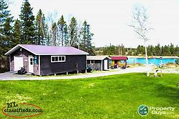 Beautiful 3 bdrm/2 bath home on a large lot right on the water