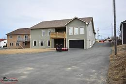 Large lot with 1100 sq/ft detached garage ideal for family business !!