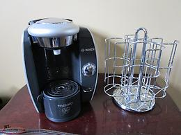 Tassimo coffee maker and pod rack.