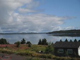 house/cabin overlooking ocean for sale in jamestown.