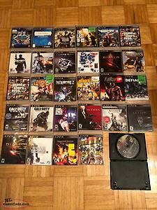 PS3 console with 2 controllers and 29 games