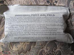 FIRST AID FIELD DRESSING.