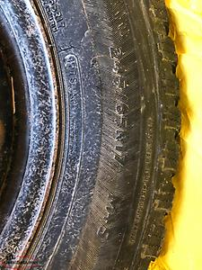 4 studded winter tires on rims from a Mazda CX9 245/65 R17