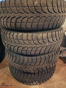 Four WinterClaw 225/65/R17 tires mounted on four 2016 Jeep Cherokee Rims