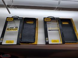 Two otter box cases