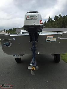 14ft aluminum boat ,motor and trailer.