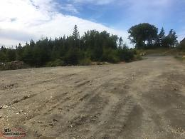 Developed 3/4 acre Building Lot on Paved road with Power and privacy