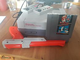 Original NES console w/ 2 controllers, zapper gun and game