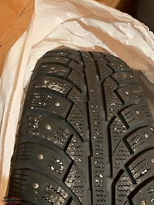 Selling 4 225/65/17 studded tires