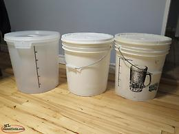 3 brewing buckets with lids.