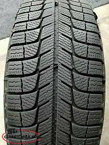 Like new 245/65/17 Michelin snow tires and aluminum rims