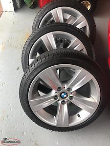 Four Michelin X Ice 225 40 18 winter tires on BMW 3 Series rims