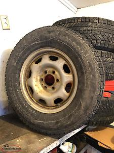 4 Studded Winter Tires on Rims with sensors (265/70-R-17).