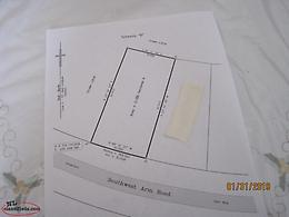 Half acre land located in Queens Cove, TB close to Clarenville, $24,900