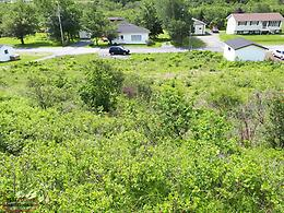 Cleared Serviced Lot in the centre of Salmon Cove NL, 3 MINUTES FROM THE SANDS