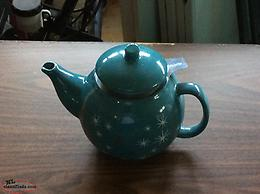 Teapot and strainer