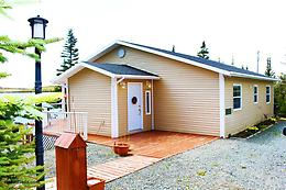 Four season 1,088 square foot cottage sits on a 1.5 acre lot