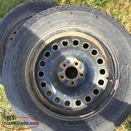 4 tires and rims 235-65-18. 114.3x5 lug pattern
