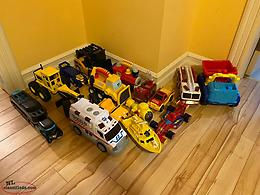 Collection of toy trucks and cars