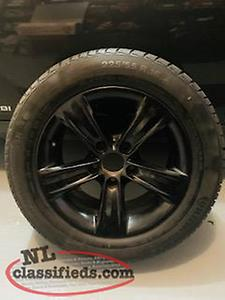 235 55 16 Run Flat Tires mounted on black alumium wheels