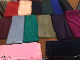 A LARGE NUMBER OF CORDUROY FABRIC IN ASSORTED COLOURS AND SIZES