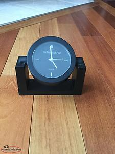 Adjustable PUCK shape desk or table clock.