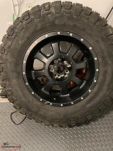 "33"" Spare Jeep tire and rim"